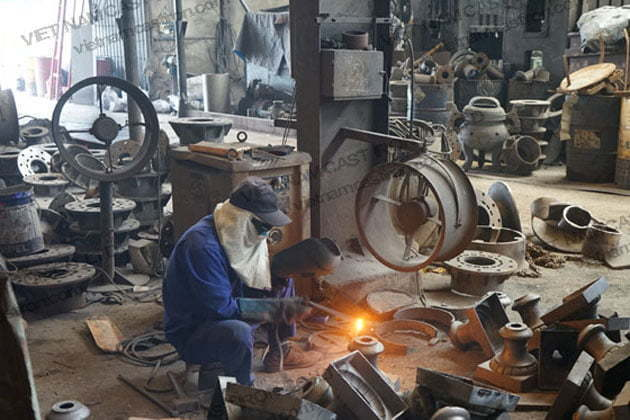 Workers are manufacturing in the factory of Vietnam Cast Iron Company