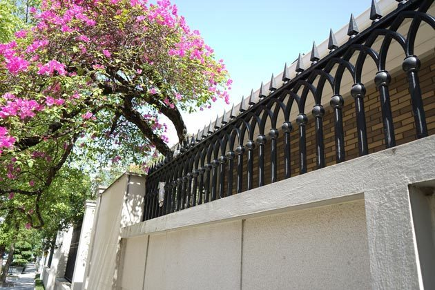 Metal wall top fence