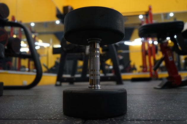 Rubber dumbbell in gym center